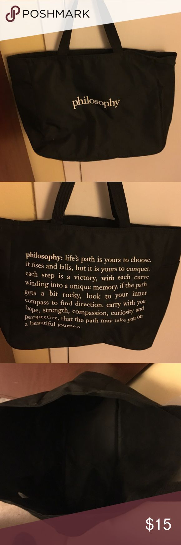 Philosophy tote bag black with white lettering Philosophy tote bag black  woven nylon canvas with white lettering says philosophy on one side and then has the definition of philosophy on the other written out.  Large opening with a small inside pocket there's also a side outside pocket. Philosophy Bags Totes