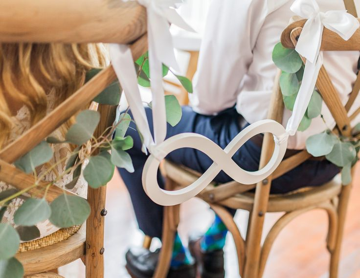 This wedding chair sign is a beautiful infinity sign for the bride and groom's chairs at the wedding reception. With this lovely prop, the wedding reception decor and photos will be unique and memorab
