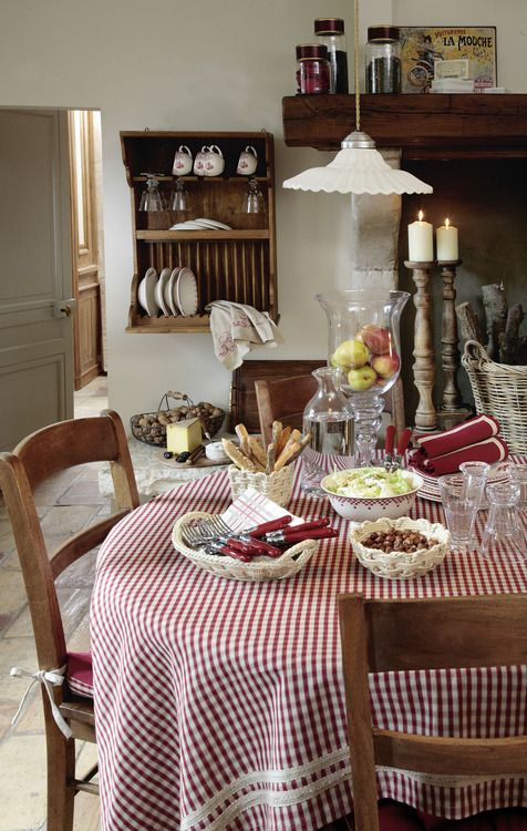 table cloth, glass tablewares, wooden chairs -perfect french kitchen