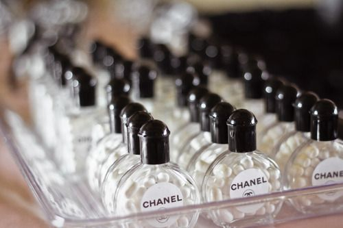 Mini perfume bottles filled with tick-tacks for Chanel Bridal Shower!