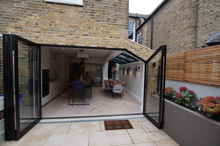 First in London full aluminium sliding - folding opening to side return with crank steel.