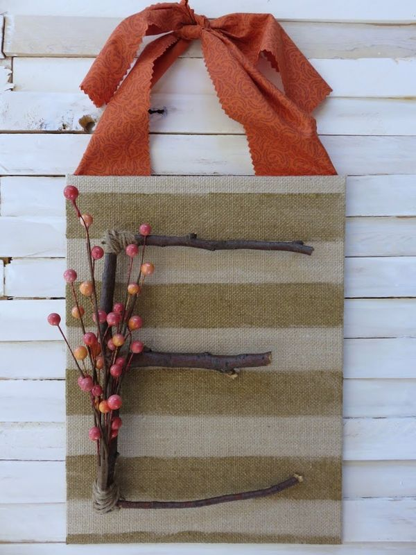 This fall door decor is a gorgeous alternative to a wreath!  Make it with branches from the yard and faux berries!
