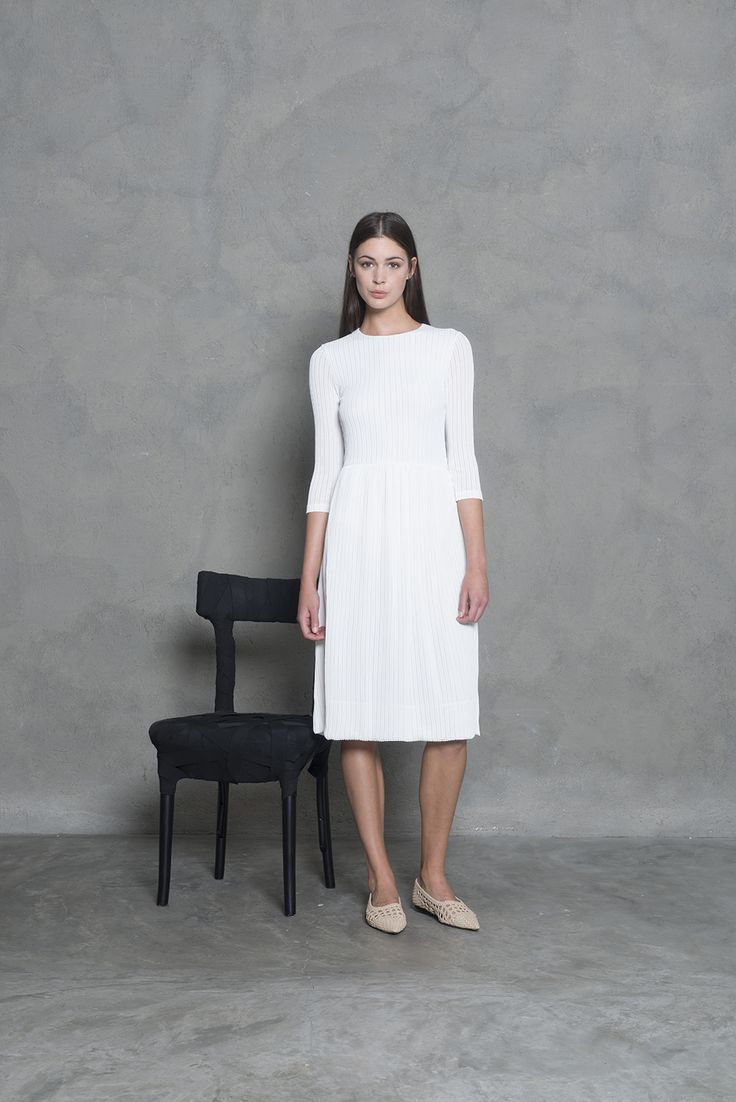 Beautiful white A - line summer dress, with 3/4 sleeves.