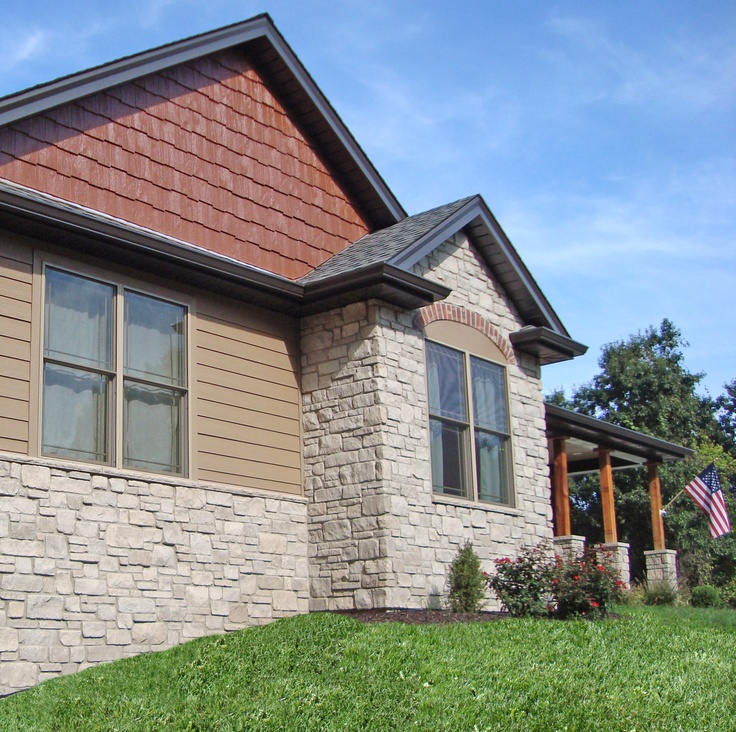 This house features siding and trim in diamond kote french E log siding