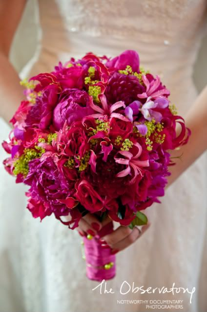 Just dandy dark pink bouquet of nerines, roses, peonies, gloriosa lilies and alchemilla for a bright green pop of color.