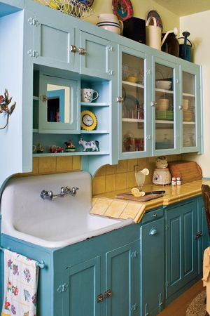 Cottage kitchen with cabinets painted in teal and sky blue.