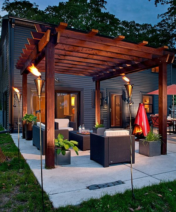 Gorgeous torches create a truly spellbinding pergola setting Outdoors Inspiration: Cool Tiki Torches To Light Up Your Magical Evenings