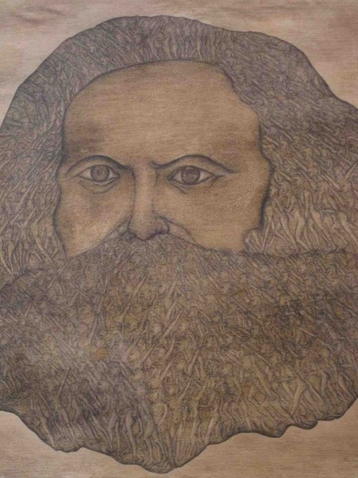 Karl Marx with subconscious masses in his beard –by Yüksel Arslan