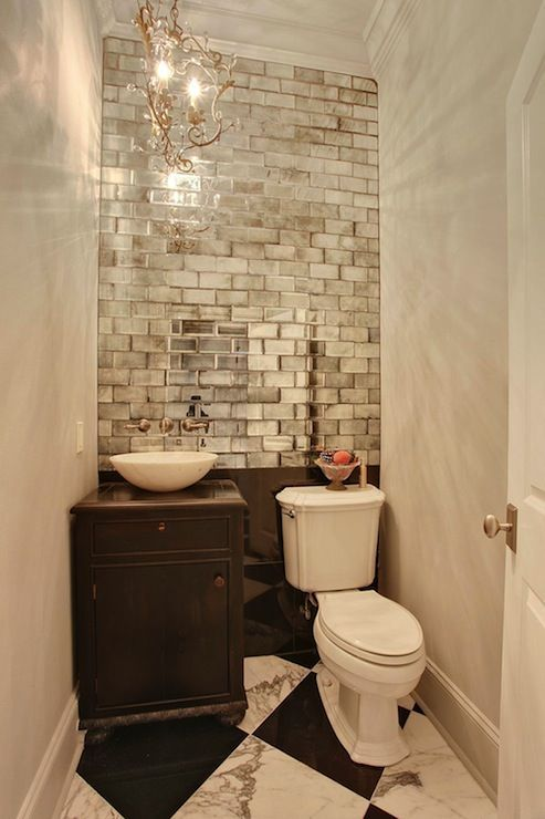 small powder room, mirrored subway tiles, accent wall