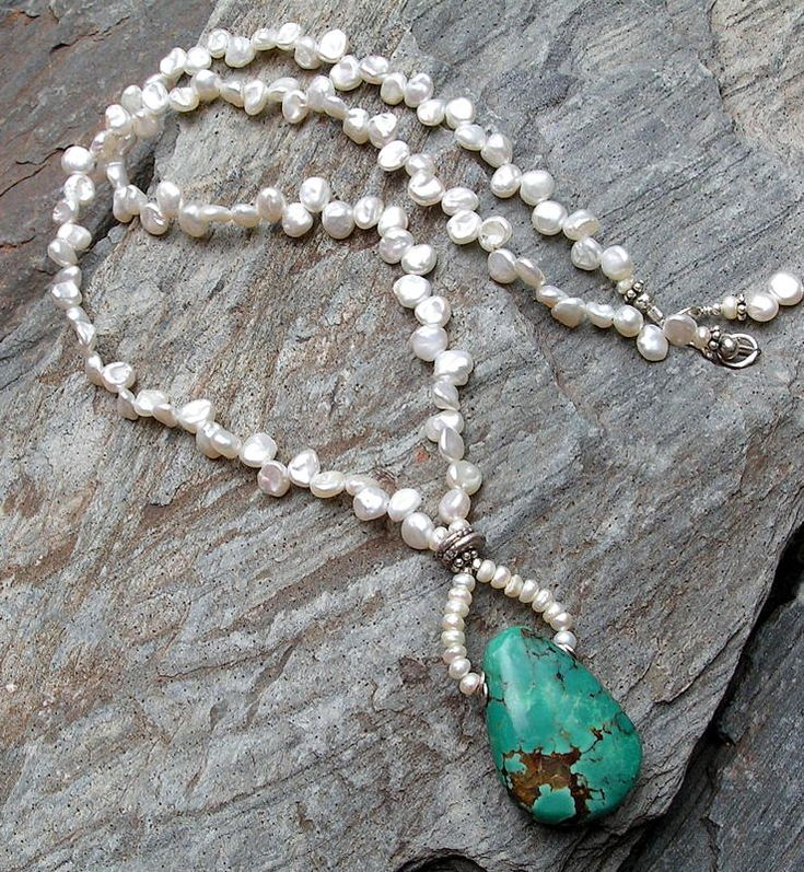 turquoise hung from custom bail and strung from freshwater keishi pearls