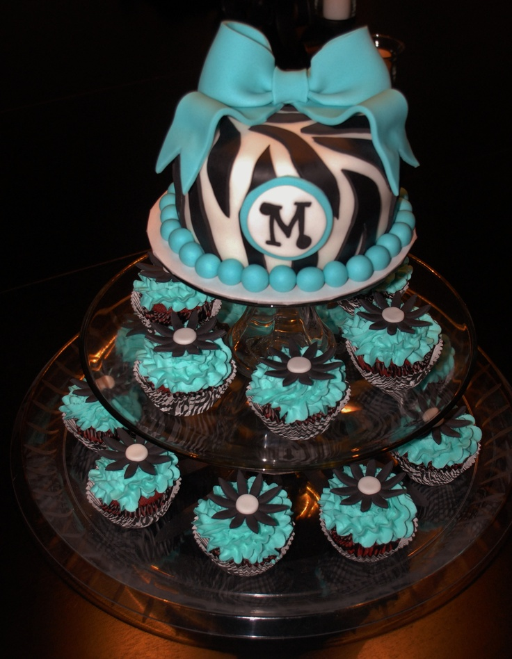 Zebra print/Tiffany blue birthday cake and cupcakes.