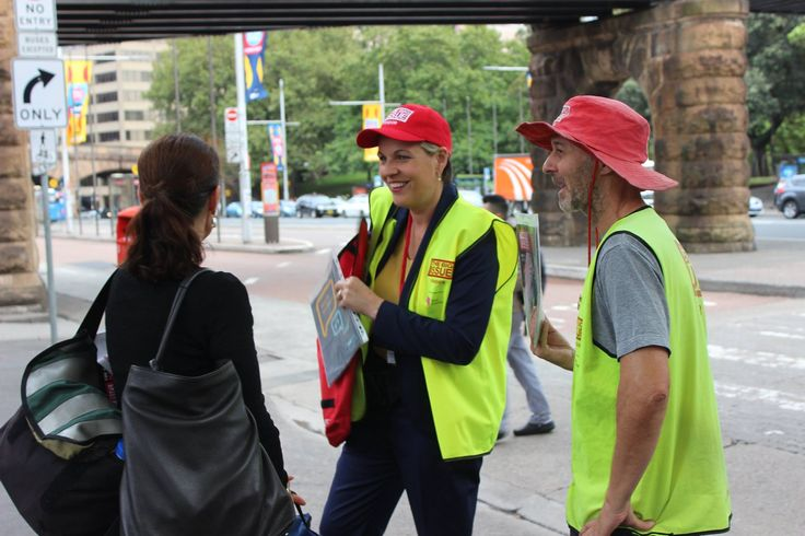 Labor MP Tanya Plibersek selling The Big Issue Australia at Sydney's Central Station alongside a vendor.
