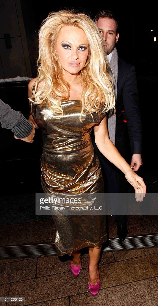 ©2010 RAMEY PHOTO /XPOSURE US ONLY! DECEMBER 18, 2010 - LIVERPOOL - UK PAMELA ANDERSON SEEN LEAVING THE EMPIRE THEATRE IN LIVERPOOL WHERE SHE IS PERFORMING IN PANTO. PAM THEN HEADED TO THE VIVA BRAZIL RESTRAURANT BEFORE MOVING ONTO THE NOBLE HOUSE WHERE SHE PARTIED THE NIGHT AWAY, AND SWAPPED SHOES, BEFORE ARRIVING BACK AT HER HOTEL AT 2:45AM! XP/DRRP