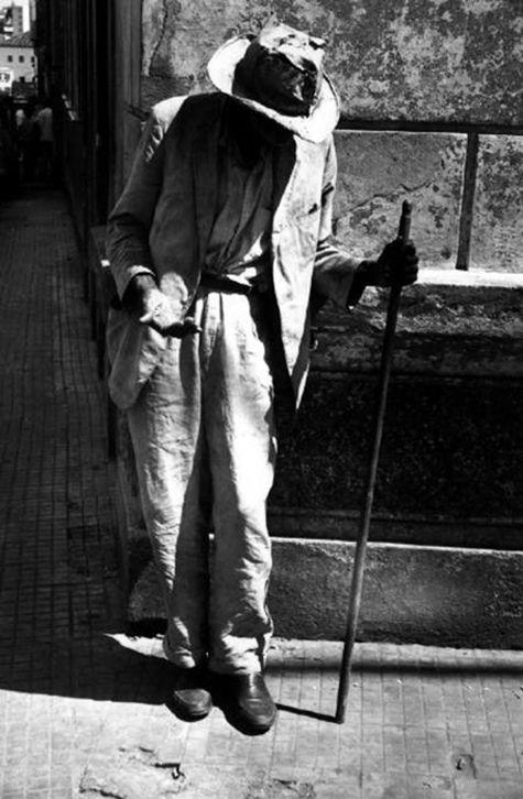 Rene Burri - Brazil. Saõ Salvador de Bahia. Beggar on the cathedral square. 1966. S)