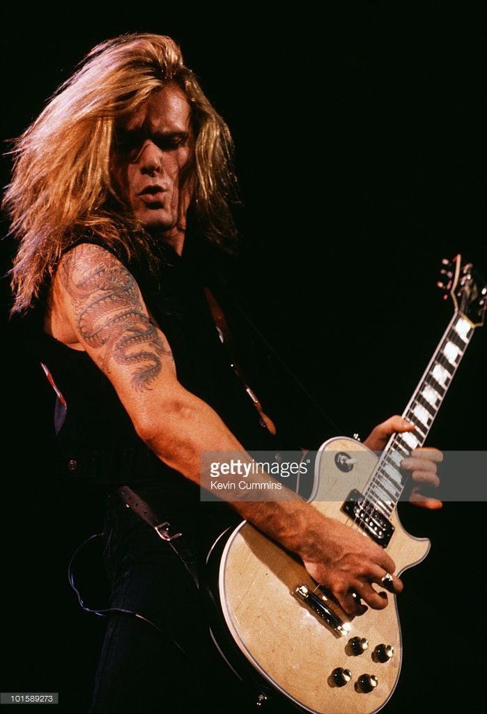 Guitarist Billy Duffy of British band The Cult performs on stage circa 1991.