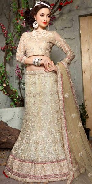 Enchanting Cream Net Lehenga Choli.