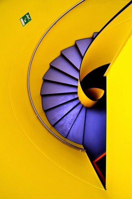 "Birdie by Eric ""Kala"" Forey. Purple spiral stairs against a yellow wall."
