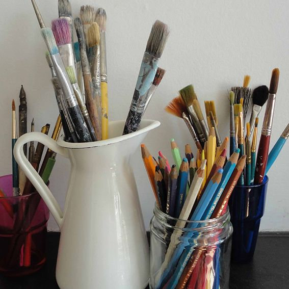 Still life of pots and brushes