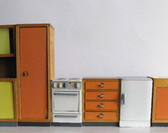 Vintage dollhouse furniture midcentury modern kitchen, scale unclear. Dollhouse stove, sink and cabinets in wood, orange and yellow