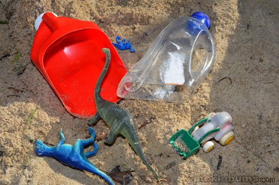Make scoops for sand and water play out of plastic bottles