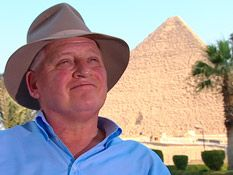 John Romer's Theory: A group of very highly skilled craftmen built the pyramid in 14 years. Read more on his theory here.
