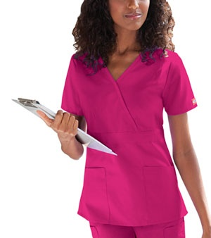 "About This Product  Classic Missy Fit, mock wrap top features and empire waist, front darts, two slanted patch pockets and side vents for ease of movement. Center back length:24 1/2"".  Fabric: 65 Poly / 35 Cotton Poplin $12.99 #scrubs #nurses #nationalnursesweek #sale #dickies"