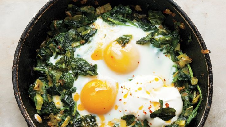 Skillet-Baked Eggs with Spinach, Yogurt, and Chili Oil Recipe   Bon Appetit