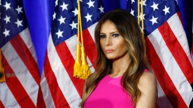 This file photo taken on June 06, 2016 shows Melania Trump, wife of Republican presidential candidate Donald Trump, listening as her husband delivers remarks at Trump National Golf Club Westchester in Briarcliff Manor, New York.