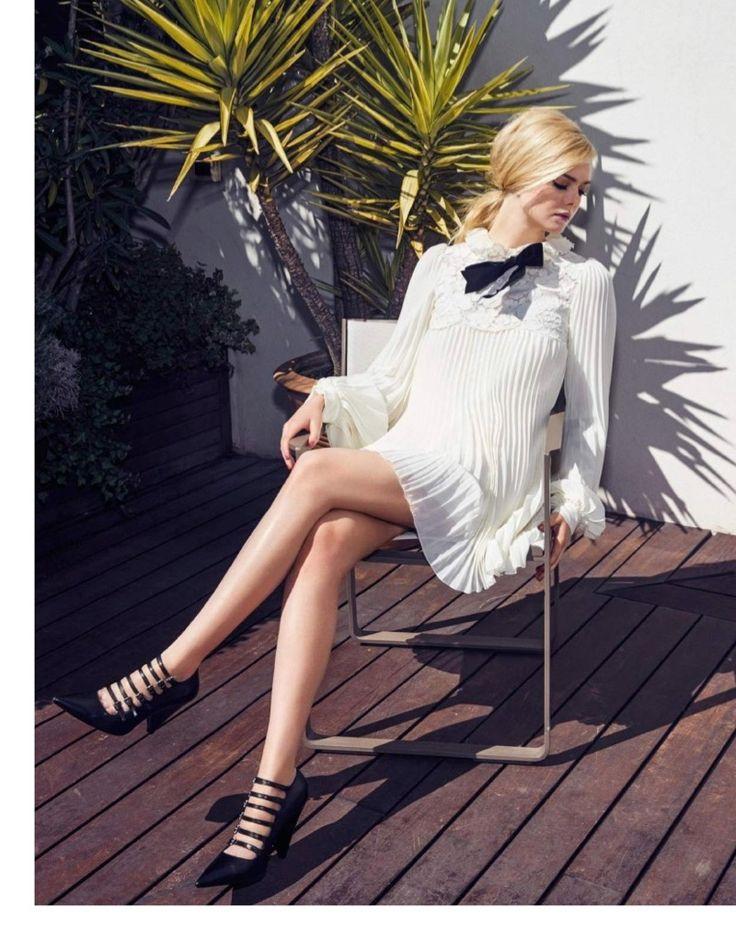 Elle Fanning poses in Philosophy Di Lorenzo Serafini dress and Michael Kors heels