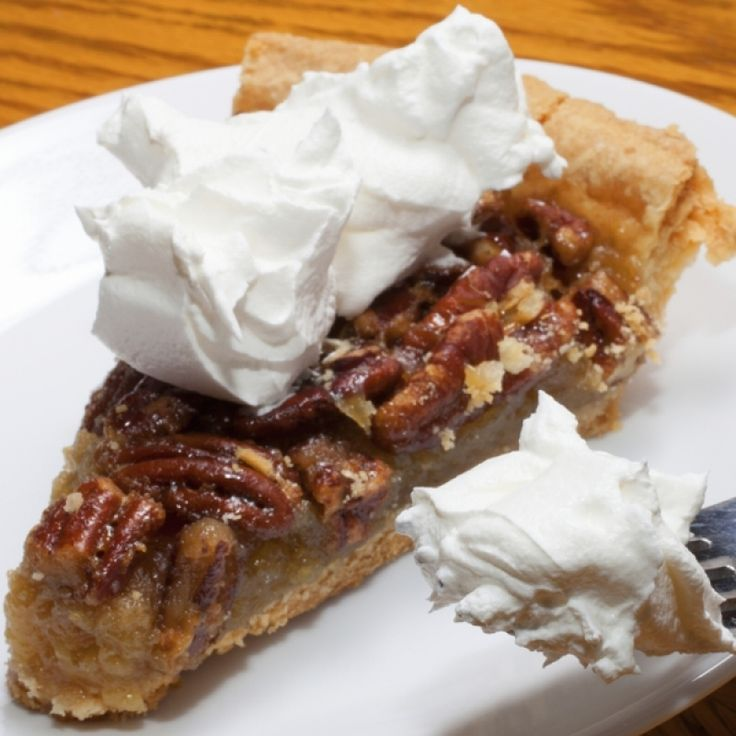 A Sweet and yummy pecan pie recipe served with fresh whipped cream.