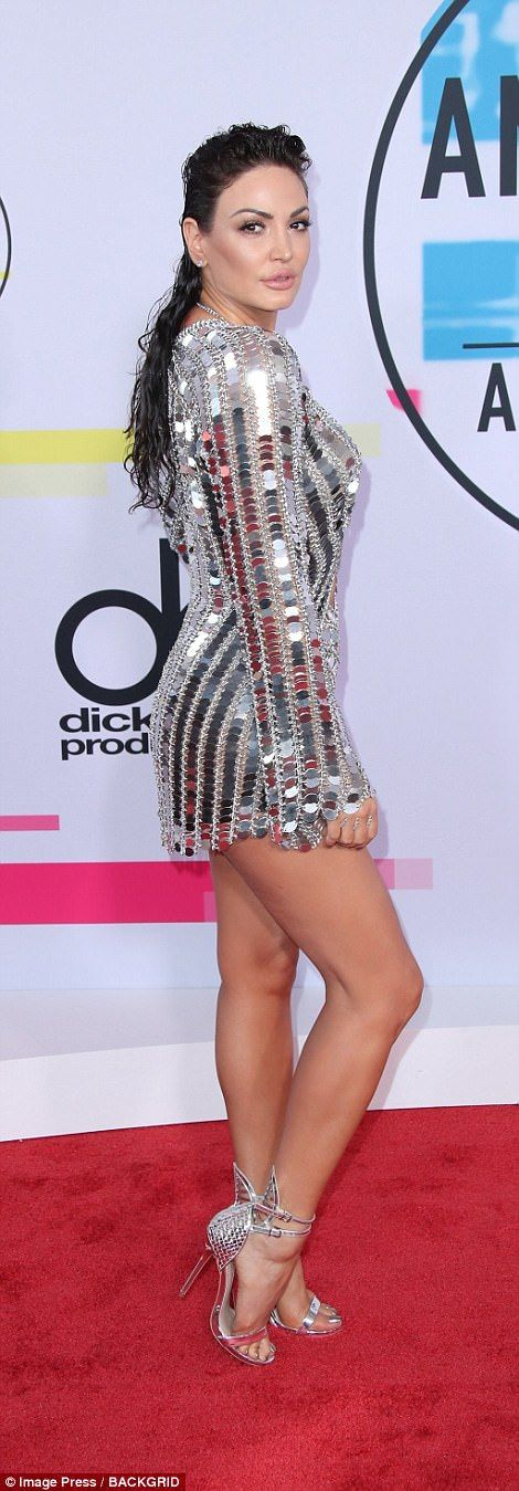 Turning heads:Bleona donned a racy silver bodysuit style dress, revealing her toned legs and her cleavage as well