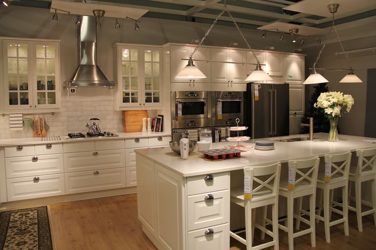 I like these cabinets especiallly the part over the frig. Even the oven vent could work. A smaller version of this with lots of organizers could work!