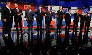 Republican presidential candidates (L-R) Chris Christie, Marco Rubio, Dr. Ben Carson, Scott Walker, Donald Trump, Jeb Bush, Mike Huckabee, Ted Cruz, Rand Paul and John Kasich pose at the start of the first official Republican presidential candidates debate in Cleveland, Ohio