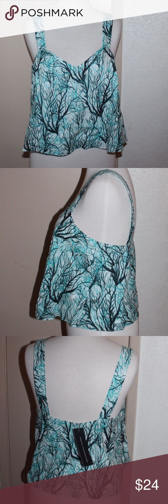 French Connection sea fern cotton crop NWT 72DNM French Connection sea fern cotton crop NWT style 72DNM colour: 30 west lake multi s/less top US size 6 UK 10 FA 38 CA 34338 RN 53372 MSRP $68.00 sku 8 86928 42354 7 French Connection Tops