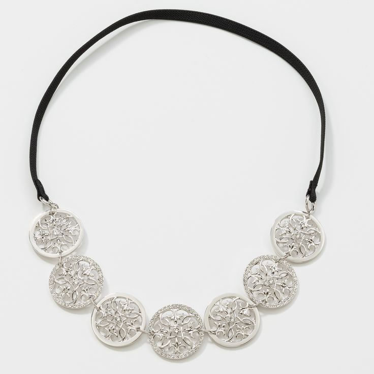 "Convertible necklace can also be worn as a headband!  Crystal; rhodium plating and black elastic band; 20"" total length."