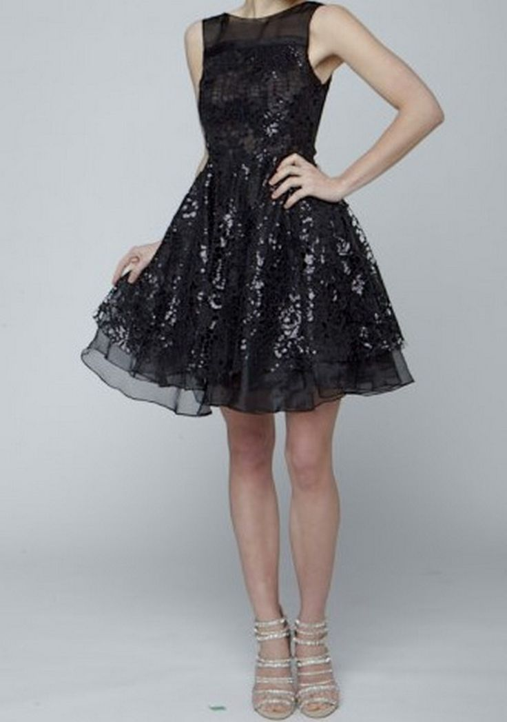 Designed by Narces, this black 100% silk organza Gabrielle dress features a sequin lace overlay for a shining effect.  Get ready to party in this little number!  Available through Pinktiger.com.