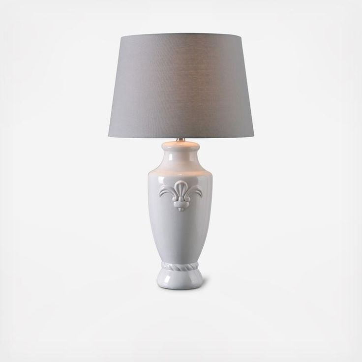 Composed of a classic and regal design, the Crackle table lamp features a gorgeous floral accent on the face of the white crackle ceramic finished body, and topped with a 17-inch diameter shade.