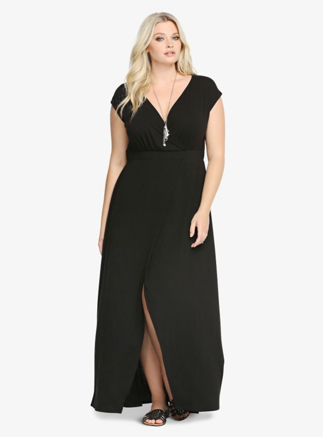 "Go ahead, max yourself out. This black dress is long on style with an alluring tulip cut split and surplice neckline that add an air of sexiness. It's a soft, comfortable knit number with an appealing feel. An elastic waistband finishes off this look in a way that's sure to contour your figure.<br><br><b>Model is 5'9"", size 1</b>"