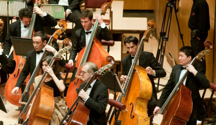 The members of the #SOI play during the orchestral concert.