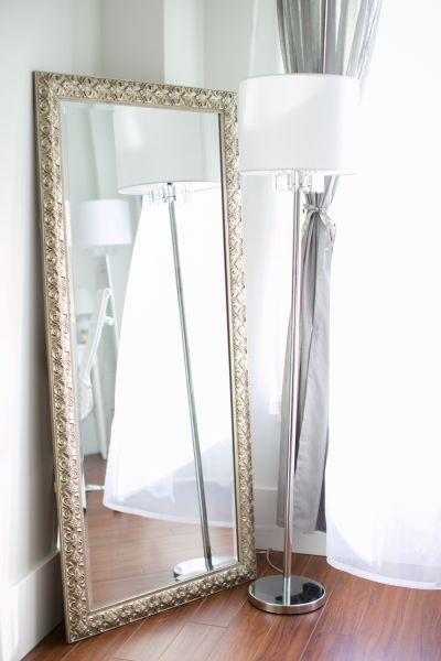Chic grey curtains and metal grey framed body mirror: http://www.stylemepretty.com/living/2016/09/29/reasons-were-still-not-over-gray/ Photography: Jenn Best - http://jennbest.ca/