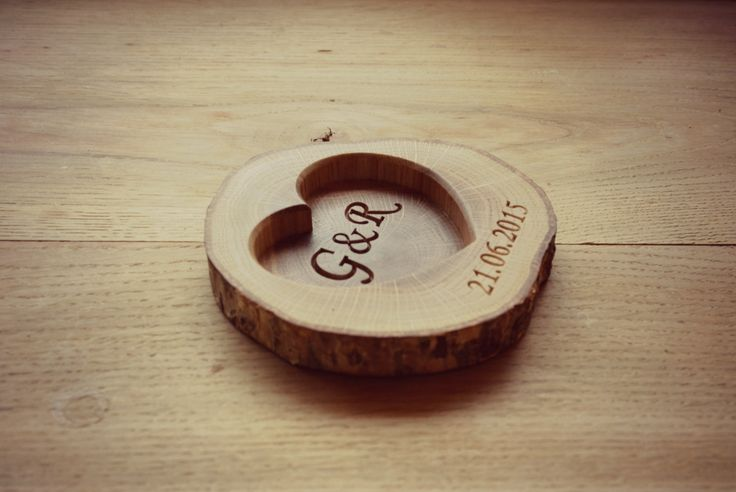 Personalized #rustic #wedding ring holder. Made of an old #oak tree slice.  More: https://www.etsy.com/listing/233724948/personalized-wood-ring-holder-rustic?ref=shop_home_active_14