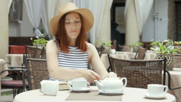 Young Pretty Woman Drinking Herb Tea #Breakfast, #Cafe, #Caucasian, #Cup, #Drink, #Enjoy, #Female, #Girl, #Hair, #Hot, #Morning, #People, #Portrait, #Puzurin, #Red, #Tea https://goo.gl/E3kQyG