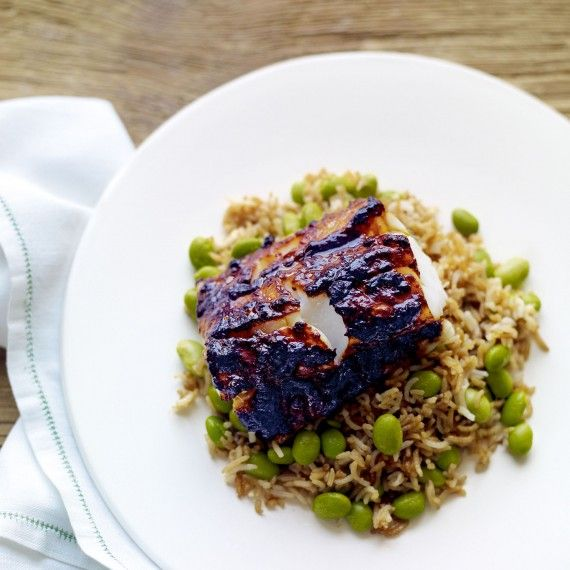 Our cheat's version of trendy restaurant Nobu's famous blackened cod recipe, this miso-grilled cod with edamame fried rice recipe is something special to enjoy midweek!