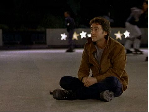 This scene is in the end of the movie Serendipity. John Cusack and the beautiful Kate Beckinsale did an amazing job playing two sides of the same soul. Oh I love this movie, especially the scene that starts with John sitting on the ice where they both were years ago.