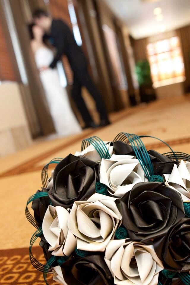 Teardrop bouquet in black, ivory and turquoise.                             www.flaxation.co.nz