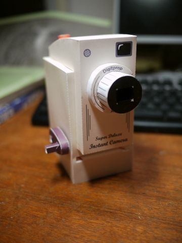 "Learn how to make a paper toy camera that prints ""real"" pictures!  Oh my gosh, how cute!"