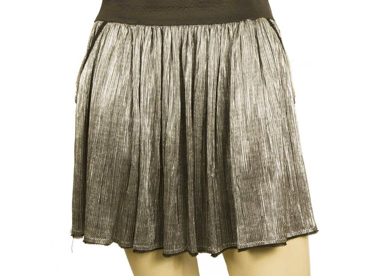 Girly, hip and modern Zadig & Voltaire mini skirt that features silver color with black elastic waist ribbon, 2 front pockets and funky pleats. Pair it with a simple top and heels or with a pair of sneakers and wear it from campus to club!!