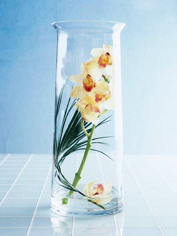 Think Inside the Vase: Twist a small palm frond or banana leaf into a tall cylinder vase as a backdrop for a delicate white orchid branch.  --Float a single blossom at the bottom of the vase and display.Beautiful Flower, Arrangements Ideas, Home Interiors, Home Accessories, Floral Arrangements, Tips And Tricks, Silk Flower Arrangements, Vases Arrangements, Blossoms
