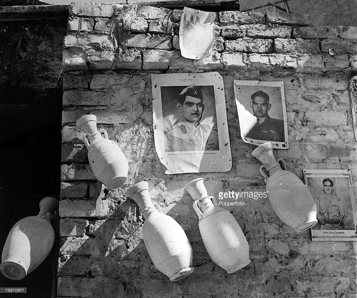 circa 1959, Baghdad, Photographs of world leaders frequently on sale in Baghdad after the Iraq Revolution, the leader of the Revolution Qasim is prominently shown, General Abd al-Karim Qasim, (Kassem) led the military coup the Revolution of 1958, which saw the end of the monarchy in Iraq
