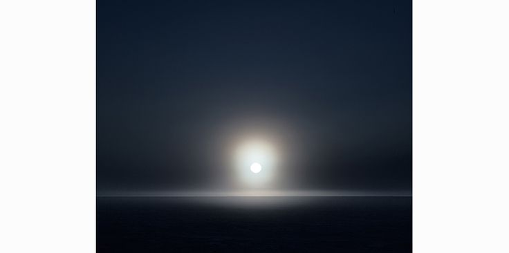 Photographed by Murray Fredericks - Love the way the sun is over exposed and the ocean is hidden in darkness making the image simplistic and effective